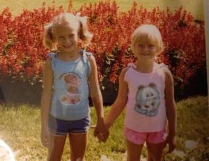"My favorite photo of Julie (pink) and me (blue). My dad instructed us to ""hold hands and pretend to like each other."""